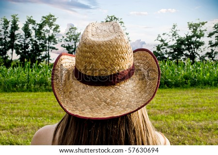 Cowgirl from back - stock photo