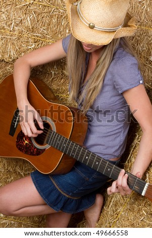 Cowgirl Playing Guitar - stock photo