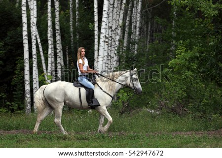 Cowgirl riding horse outdoors