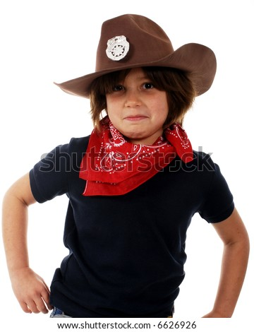 Cowgirl sheriff trying to look tough while getting ready to draw her weapons. - stock photo