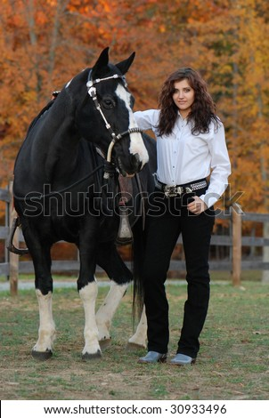 Cowgirl with Horse - stock photo