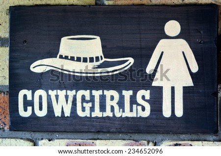 Cowgirls toilet sign and symbol, concept photo . copy space - stock photo
