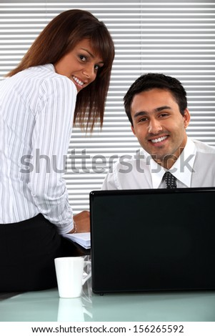 Coworkers at work. - stock photo