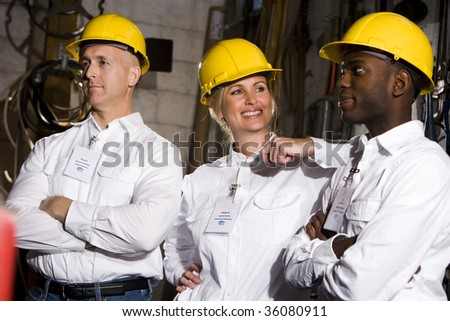 Coworkers conversing in office maintenance room - stock photo