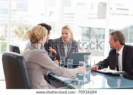 Coworkers during a meeting at work - stock photo