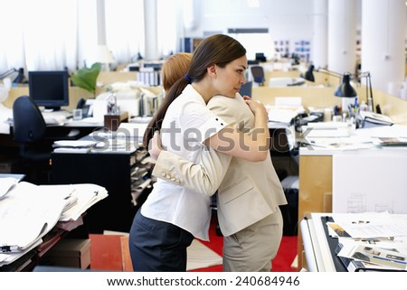 Coworkers Hugging - stock photo