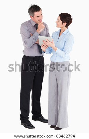Coworkers looking at tablet computer against a white background - stock photo