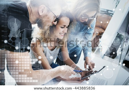 Coworkers Team Modern Office Place.Account Managers Work New Business Idea Startup Presentation.Woman Touching Digital Tablet Panel.Desktop Computer Wood Table.HiTech Diagram Interface Screen.Concept - stock photo