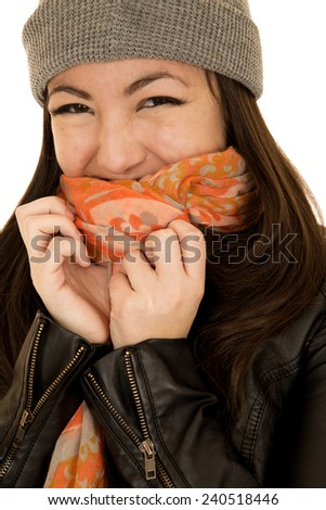 Coy teen model wearing a beanie and scarf - stock photo