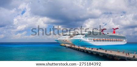 "COZUMEL, MEXICO - APRIL 4, 2008: Large cruise ships Carnival ""Valor"", and Carnival ""Conquest"" are docked in the touristic mexican port. Over 6,000 guests went out to visit tropical island. - stock photo"