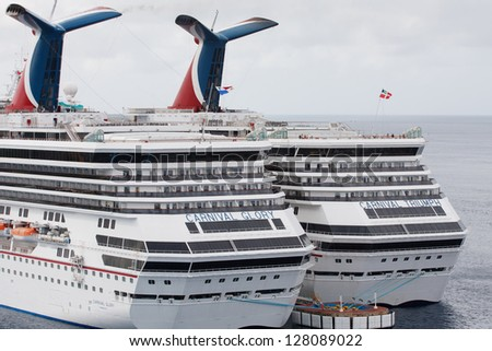 COZUMEL, MEXICO- DEC 11: The Carnival Triumph cruise ship in port in Cozumel, Mexico on December 11, 2012, 2 months before the engine fire that halted it at sea. - stock photo