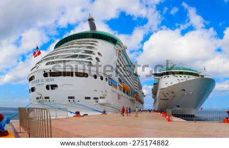 """COZUMEL, MEXICO - JANUARY 9, 2012: """"Voyager of the Seas"""" giant cruise ship docked in the tropical port. Over 3,500 passengers went out to visit the island. - stock photo"""