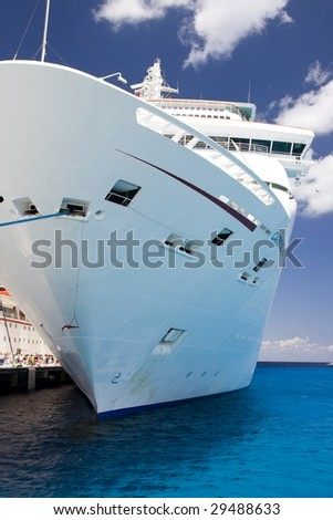 COZUMEL, MEXICO - MARCH 23 : Carnival Inspiration Cruise ship docks at the harbor March 23, 2009 in Cozumel, Mexico. - stock photo