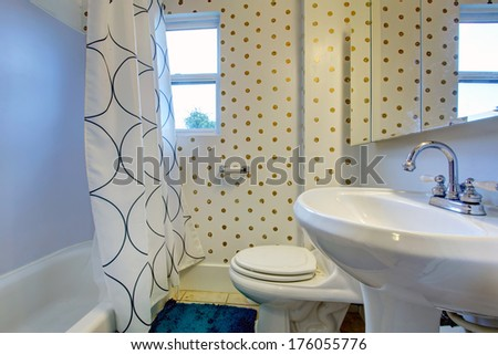 Cozy bathroom with polka dot design wall - stock photo