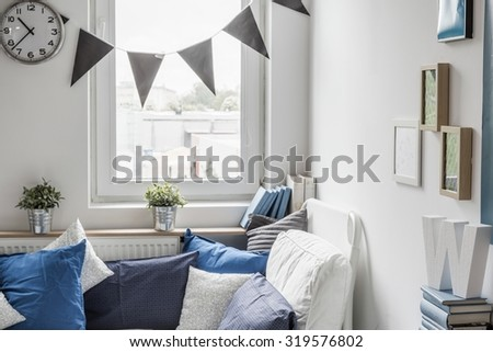 Cozy bedroom for child with small window - stock photo