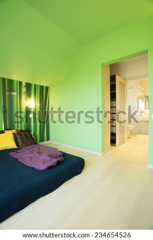 Cozy bedroom interior with green painted walls - stock photo