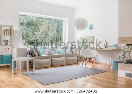 Cozy bright living room and big window - stock photo