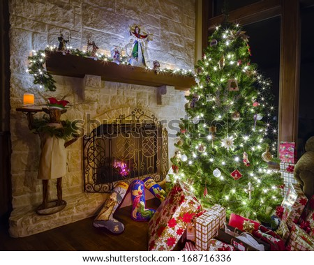 Cozy Christmas scene featuring a fireplace, gifts, and a decorated tree - stock photo
