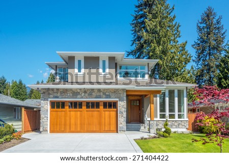 Cozy house on a sunny day. Home exterior. - stock photo