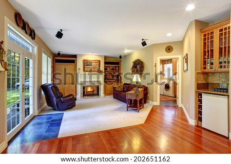 Cozy living room with fireplace and walkout deck - stock photo