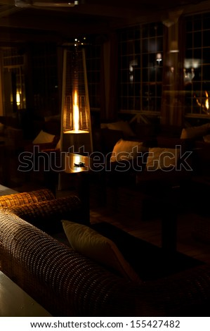 cozy night interior with electric heater  - stock photo