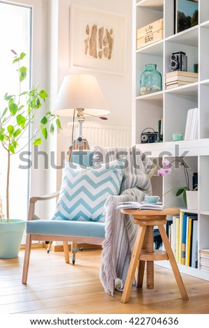 Cozy reading corner with armchair.