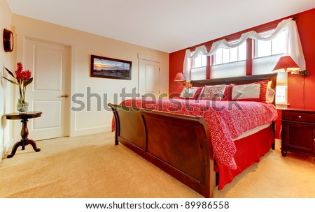 Cozy romantic red bedroom.