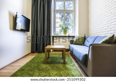 Cozy room with wall made from white bricks - stock photo
