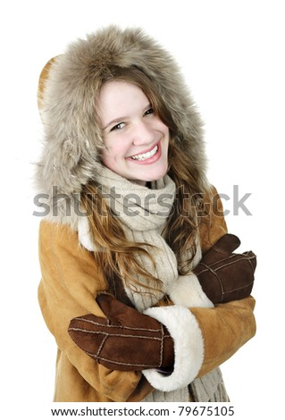 Cozy smiling young woman in winter coat on white background