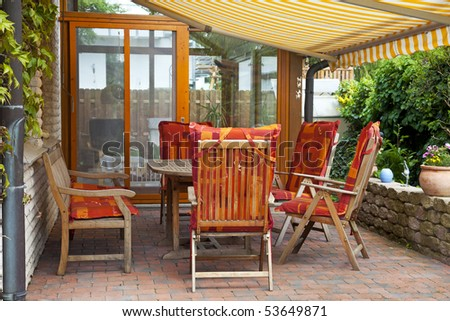 cozy Terrace with  entrance to the conservatory. - stock photo