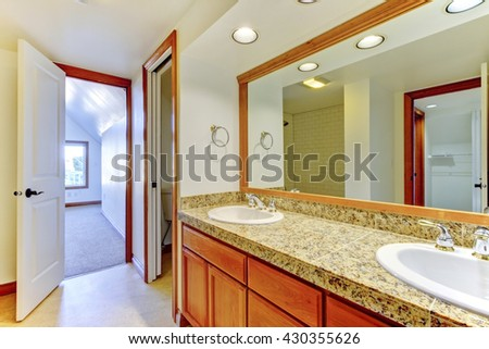Cozy white and brown bathroom with big mirror - stock photo
