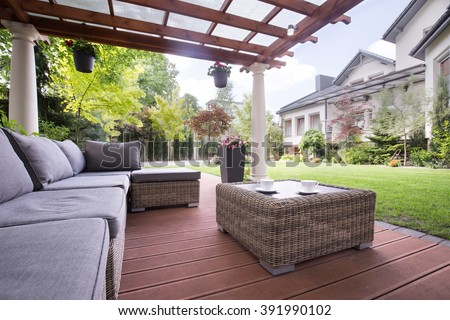 Cozy wicker couch on the terrace
