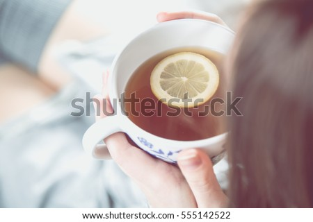 Cozy winter concept with girl drinking hot tea