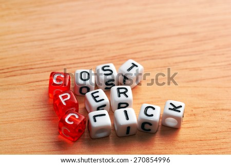 CPC Cost Per Click written  on dices on wood