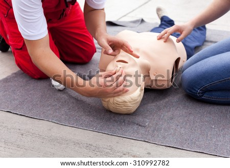 CPR. First aid training. - stock photo