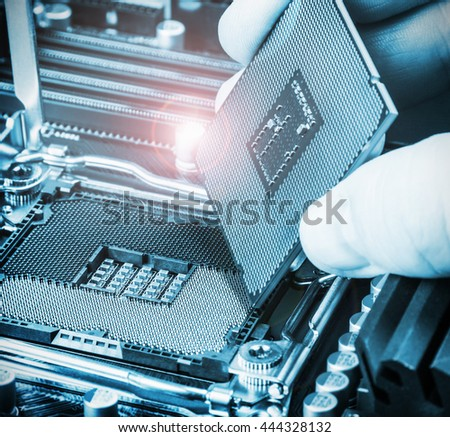 CPU in hand before installation into the motherboard. toned image - stock photo