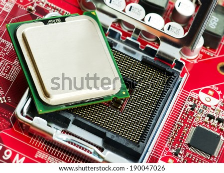 CPU socket and proccesor close up image. - stock photo