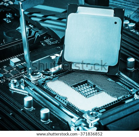 CPU socket and processor on the motherboard. Focus on the CPU. toned image - stock photo