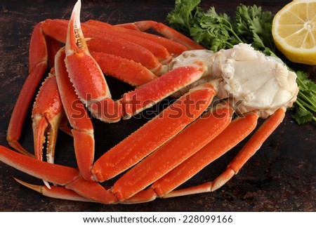 Crab legs on brown rustic background - stock photo