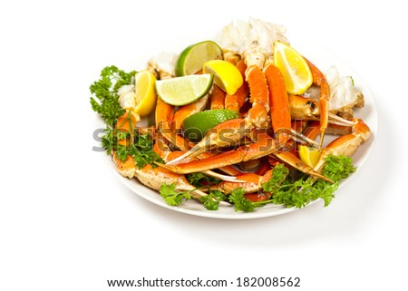 Crab legs with lemon and parsley. Selective focus. - stock photo