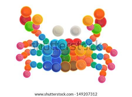 Crab made of plastic bottle cap - stock photo
