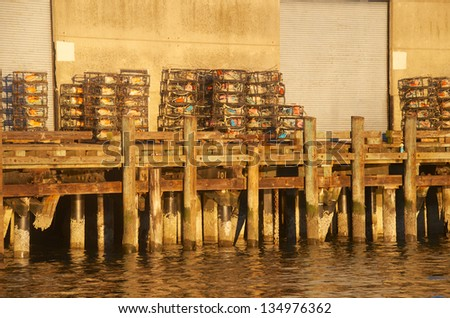 Crab pods stacked up on dock ready to be placed on a boat
