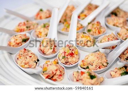Crab Salad hors odorves in single serving spoons - stock photo