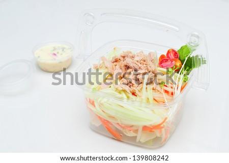 Crab salad in plastic box - stock photo