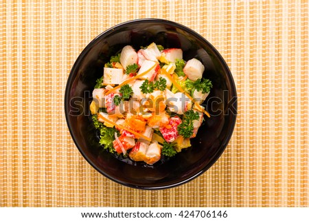 Crab salad sprinkled with shrimp eggs. - stock photo