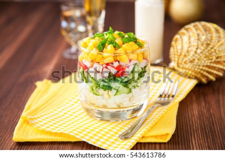 crabsticks cucumber salad in a glass on a table, selective focus, copy space
