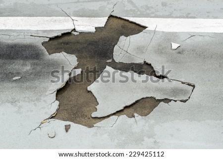 Crack burst road damage - stock photo