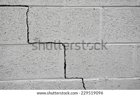 Crack in a cinder block building foundation                                - stock photo