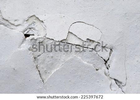 crack in plaster - crack in stucco - stock photo