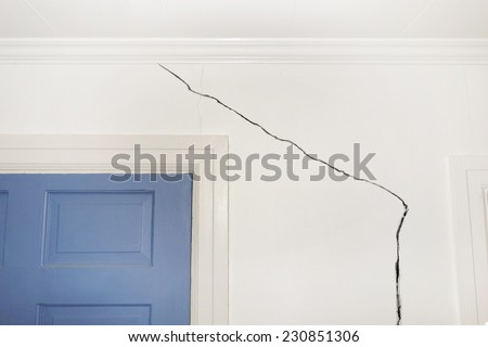 Crack in the wall of a home indicating foundation defects                                - stock photo